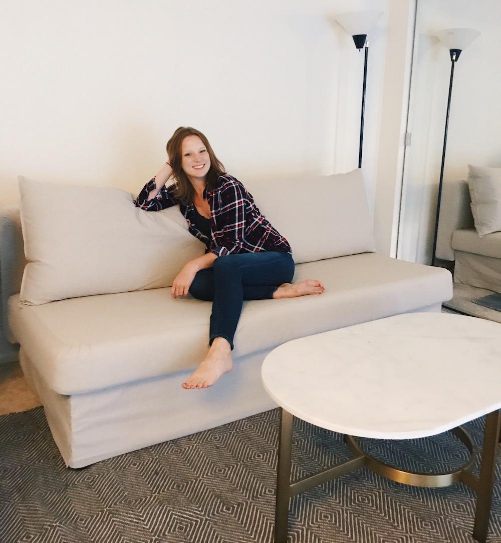 Girl sitting on beige futon