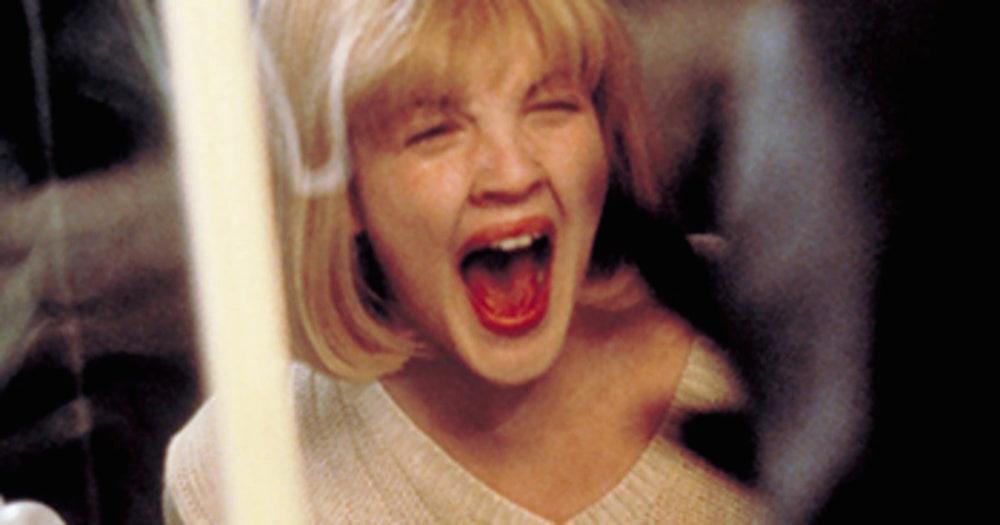 Blonde girl screaming in movie