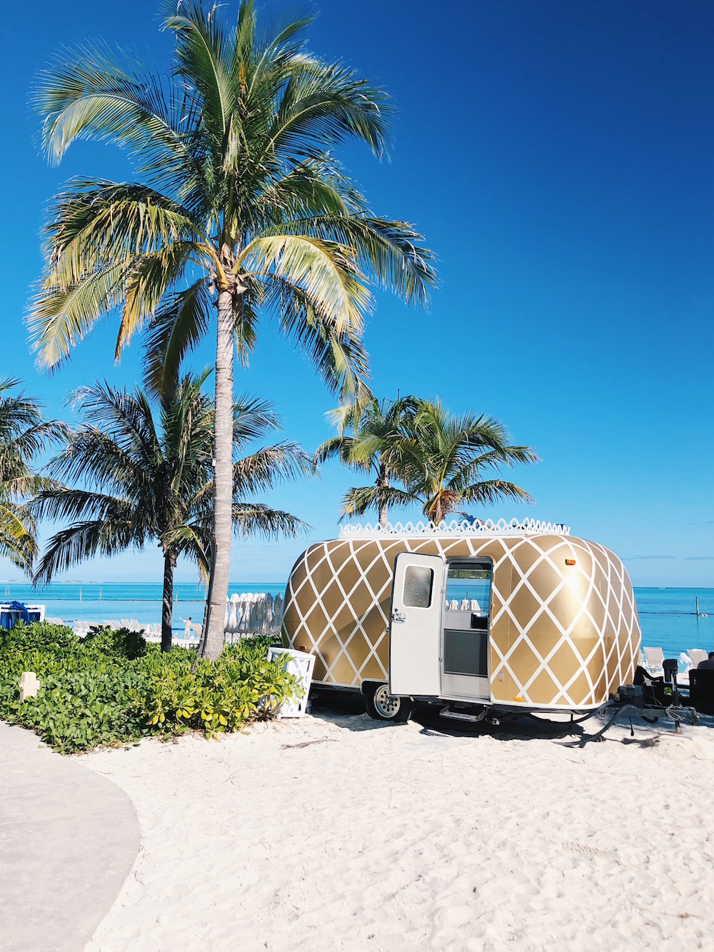Gold white airstream pineapple print food truck on beach Grand Hyatt Baha Mar Bahamas
