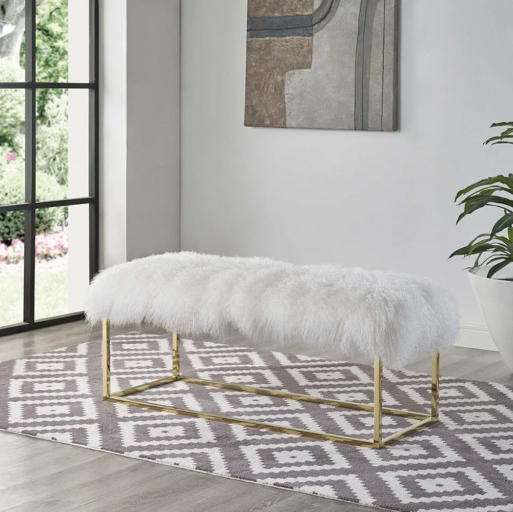 White sheepskin bench with gold legs