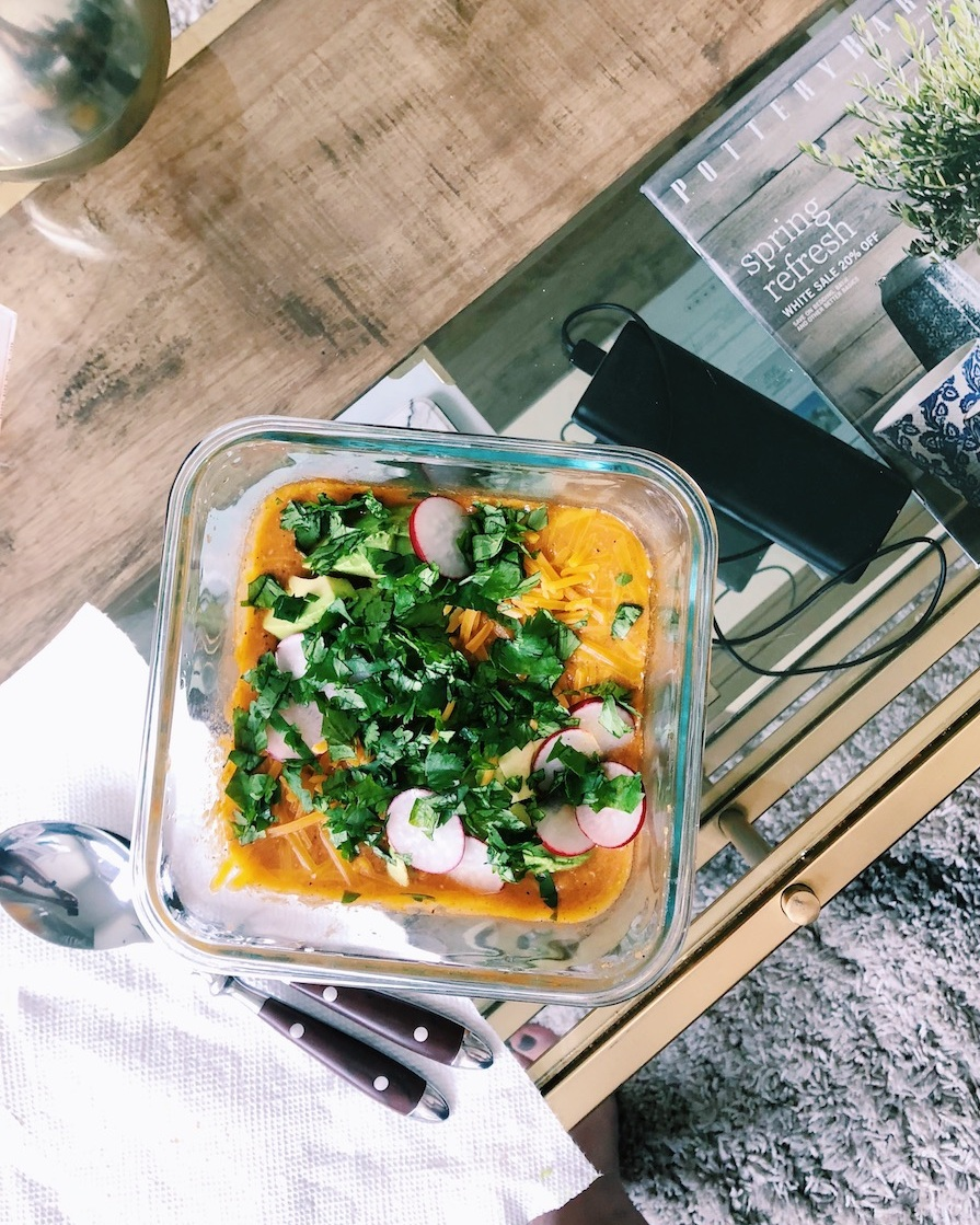 Tortilla soup with chopped cilantro and radish