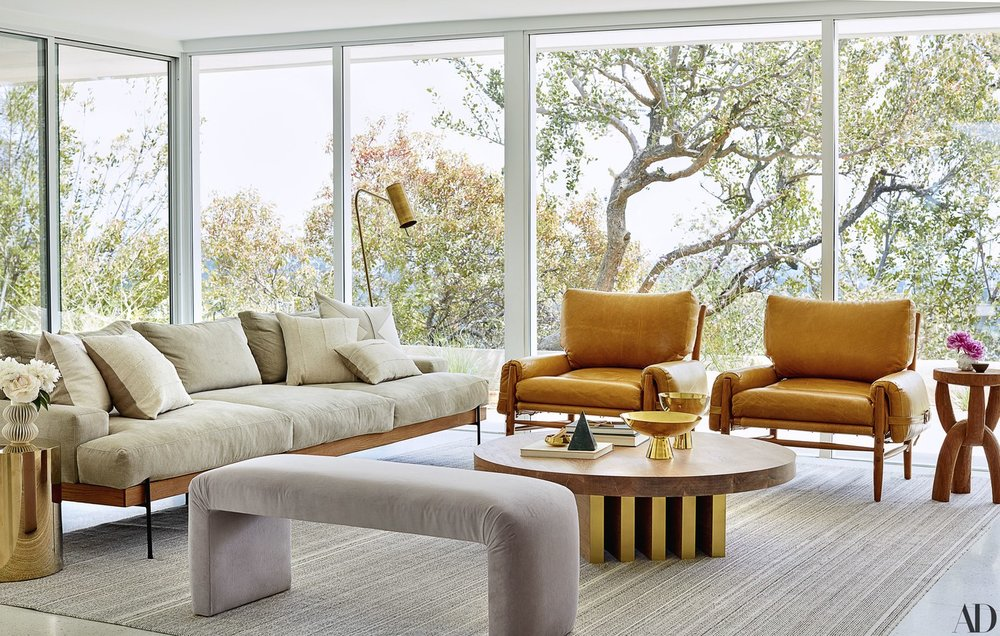 We love these leather armchairs by  Anthropologie  that go perfectly with the  Croft House  sofa and chic & funky table by  Sarah Sherman Samuel  in the family room.