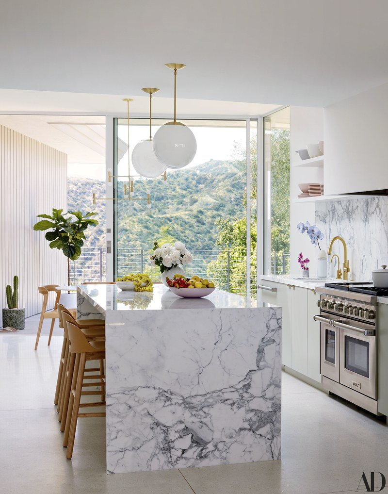 We'll happily sit on those  Jasper Morrison  counter stools from  Design Within Reach  at the Calacatta-marble island while Mandy & Taylor whip up some appetizers for a dinner party! Also love the pendants by  Cedar & Moss , the  Mark Churchill  ceramics &  Wolf  gas range.
