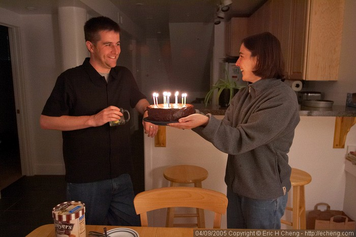 Monica presents Elliot a cake for his 31st birthday