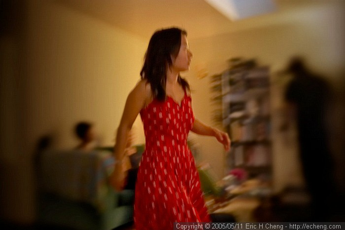 Livia wanders across the living room