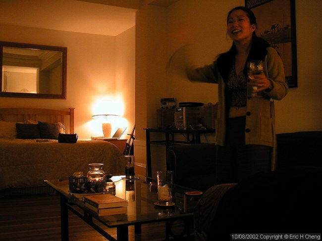 Livia, excited about something, in Jay's apartment