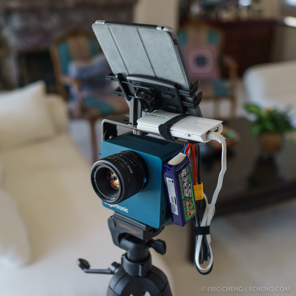 edgertronic high speed camera, configured for field use with 2200 mAH 3S LiPo battery, TP-LINK TL-MR3040 v2 mobile wireless router, L-bracket, tablet tripod adapter, and Apple iPad Mini Retina.
