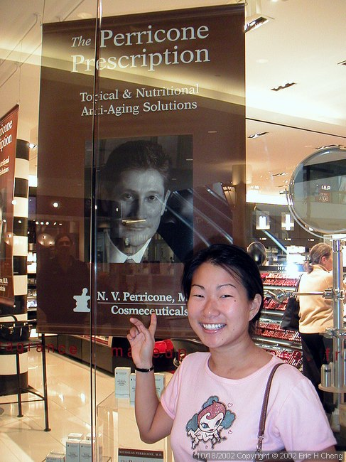 Livia, with a photo of her old dermatologist (at Sephora)