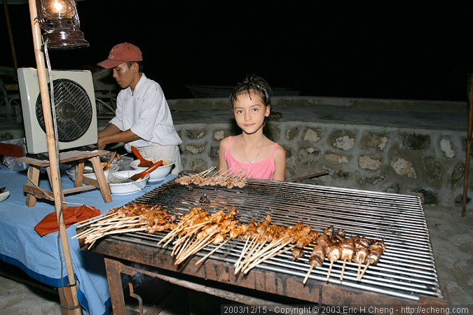 Chef and Inka, serving satay
