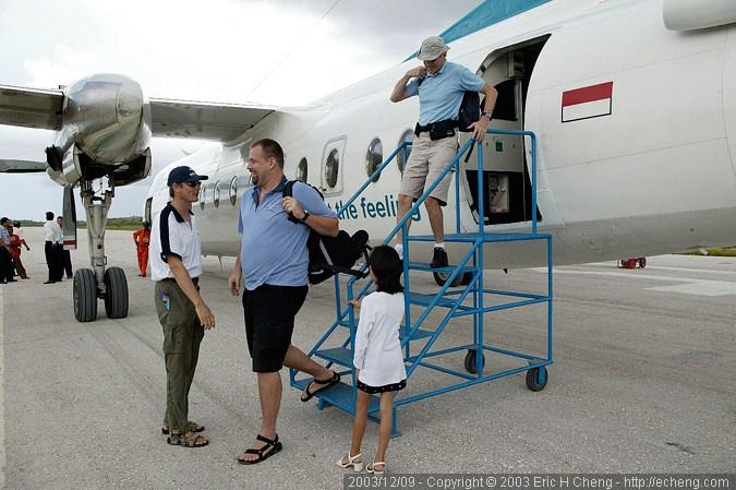 Niklas is greeted by Lorenz and Inka, at the Wakatobi airstrip