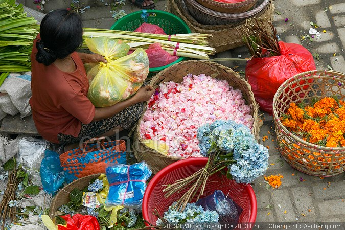 This woman is making the little offerings you see at temples