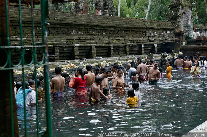 Visitors bathe in and collect holy water