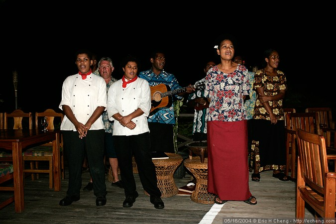 "The hotel staff at Wananavu Resort sing us a farewell song (""Isole""). Notice the drunken New Zealander pretending to sing along."