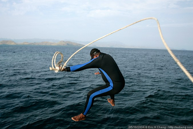 Seci leaps into the water to set a mooring line