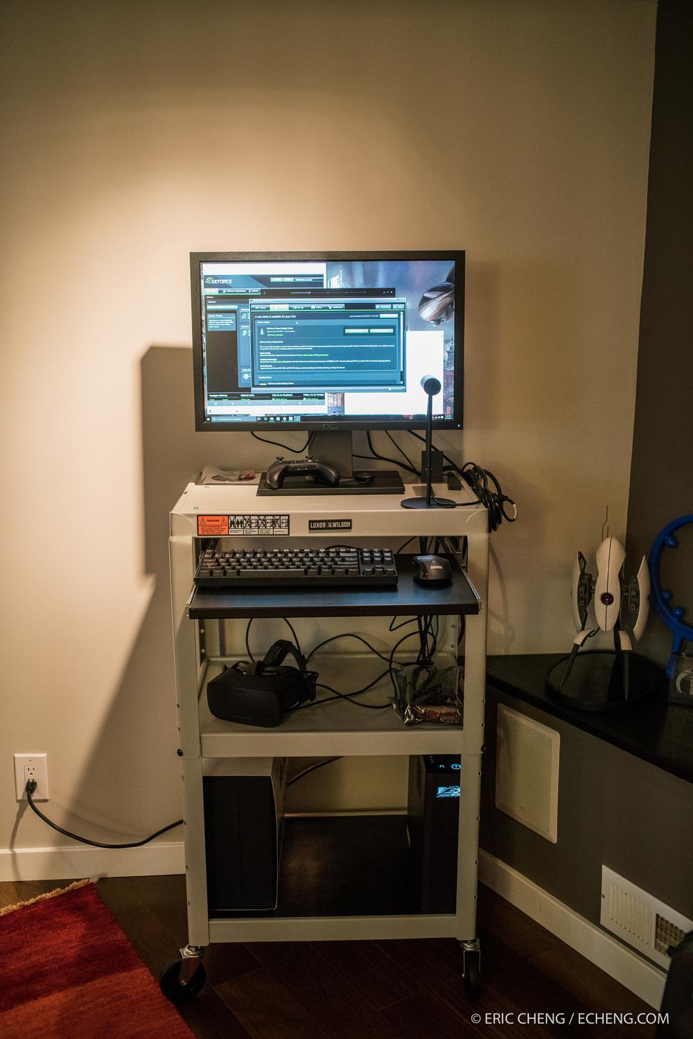 "A rolling Oculus Rift station:LUXOR AVJ42KB Presentation Cart, Falcon Northwest Tiki, Dell 24"" monitor, Oculus Rift."