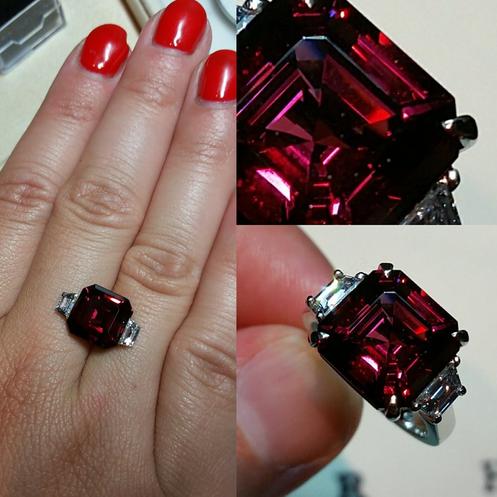 Engagement ring by Rhys James, special order featuring Asscher cut Rhodolite of 8.53 carats with two trapezoid baguette cut diamonds claw set in platinum.