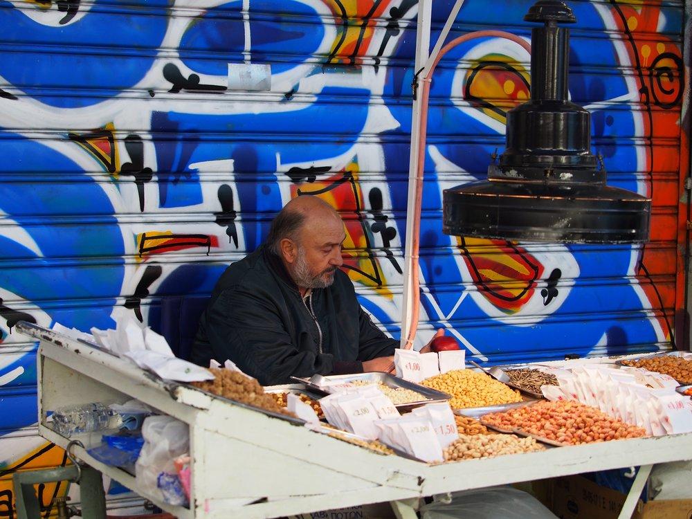 Nut seller in flea market near Monastiraki Square, Athens, November 2017.