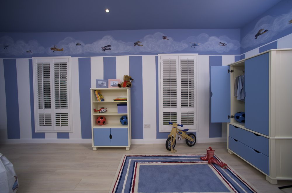 Louvre Shutters with dropped Divider Rail in Children's Bedroom