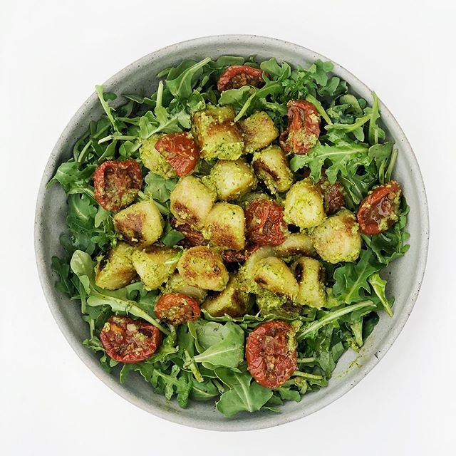 I tried the @traderjoes cauliflower gnocchi (cooked in a skillet with olive oil)...it was very good, but these @traderjoes antipasto tomatoes were amazing! Tossed with some broccoli pesto and on top of arugula.