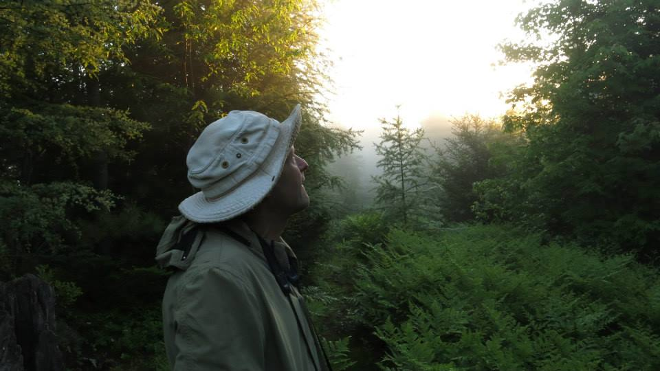 Field Ornithologist tom leckey on a frosty morning in late june.