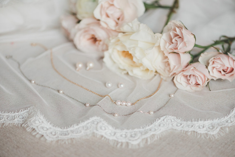 pearl wedding jewelry with roses and veil
