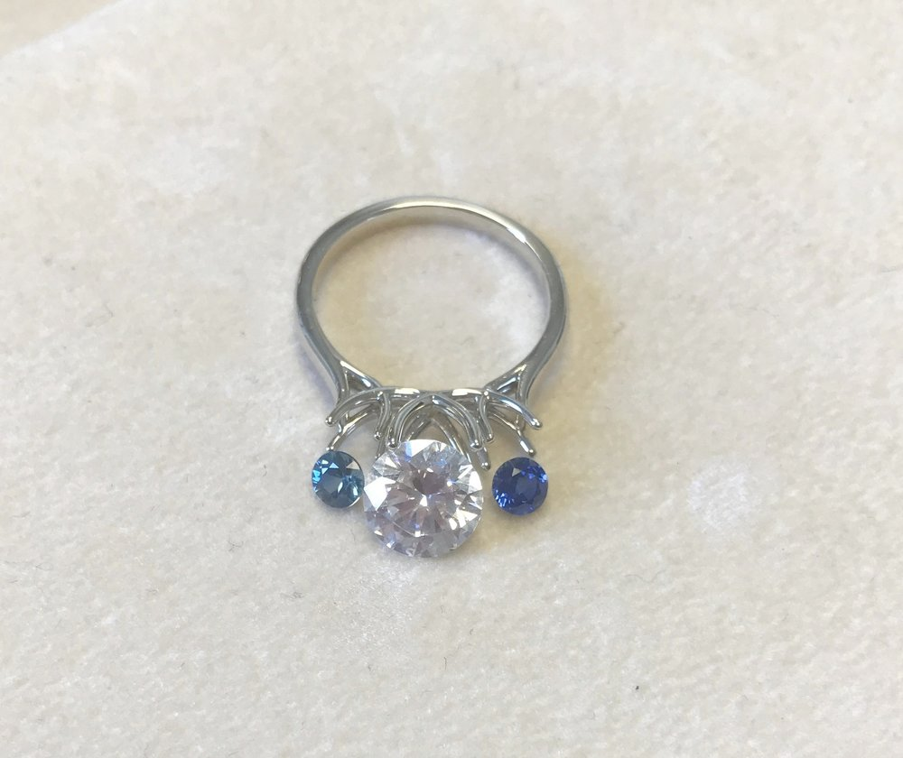 Softer sapphire on the left, darker sapphire on the right - which would you choose for this three stone diamond engagement ring?