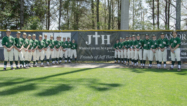 "This awesome 2015 photo of the varsity baseball team includes two of my boys standing in front of a sign honoring their dad. His favorite thing to say was, ""Whatever you are, be a good one."" Many thanks to Ben Breland for the photography."