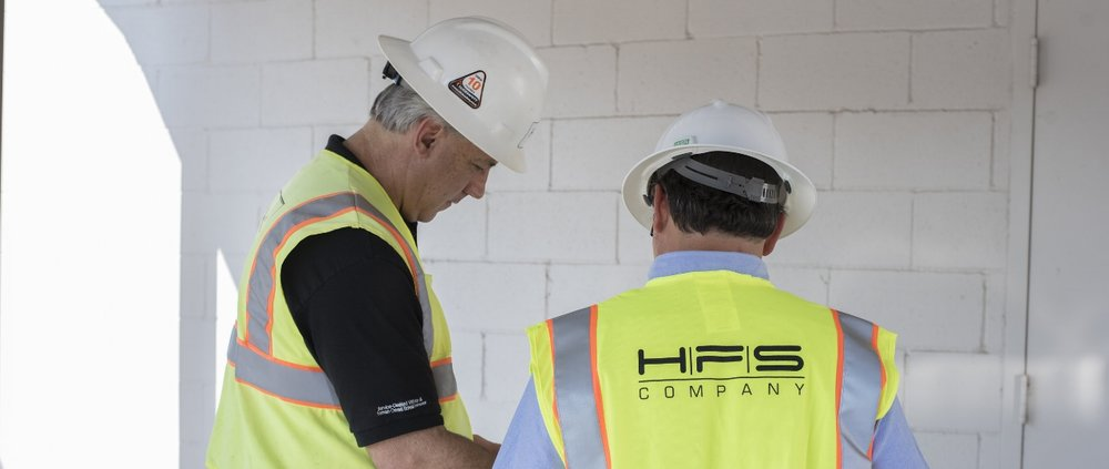 mike and wiley with construction hats.jpg