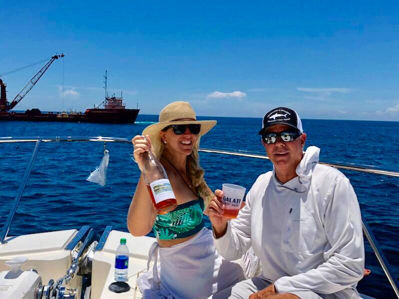 CO-Founder of 30A Coastal Dune Wines, George Barnes with artist Allison Wickey, as they witness the installation of the Octopus created by Wickey. 30A Coastal Dune Wines is a proud sponsor of Wickey and S.W.A.R.A.