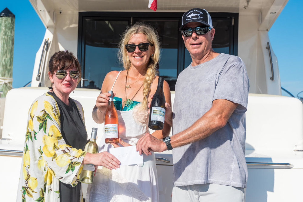 CAA Executive Director, Jennifer Steele with artist Allison Wickey and co-founder of 30A Coastal Dunes Wine Company, George Barnes  – celebrating the deployment of underwater sculptures opening in Grayton Beach State Park.