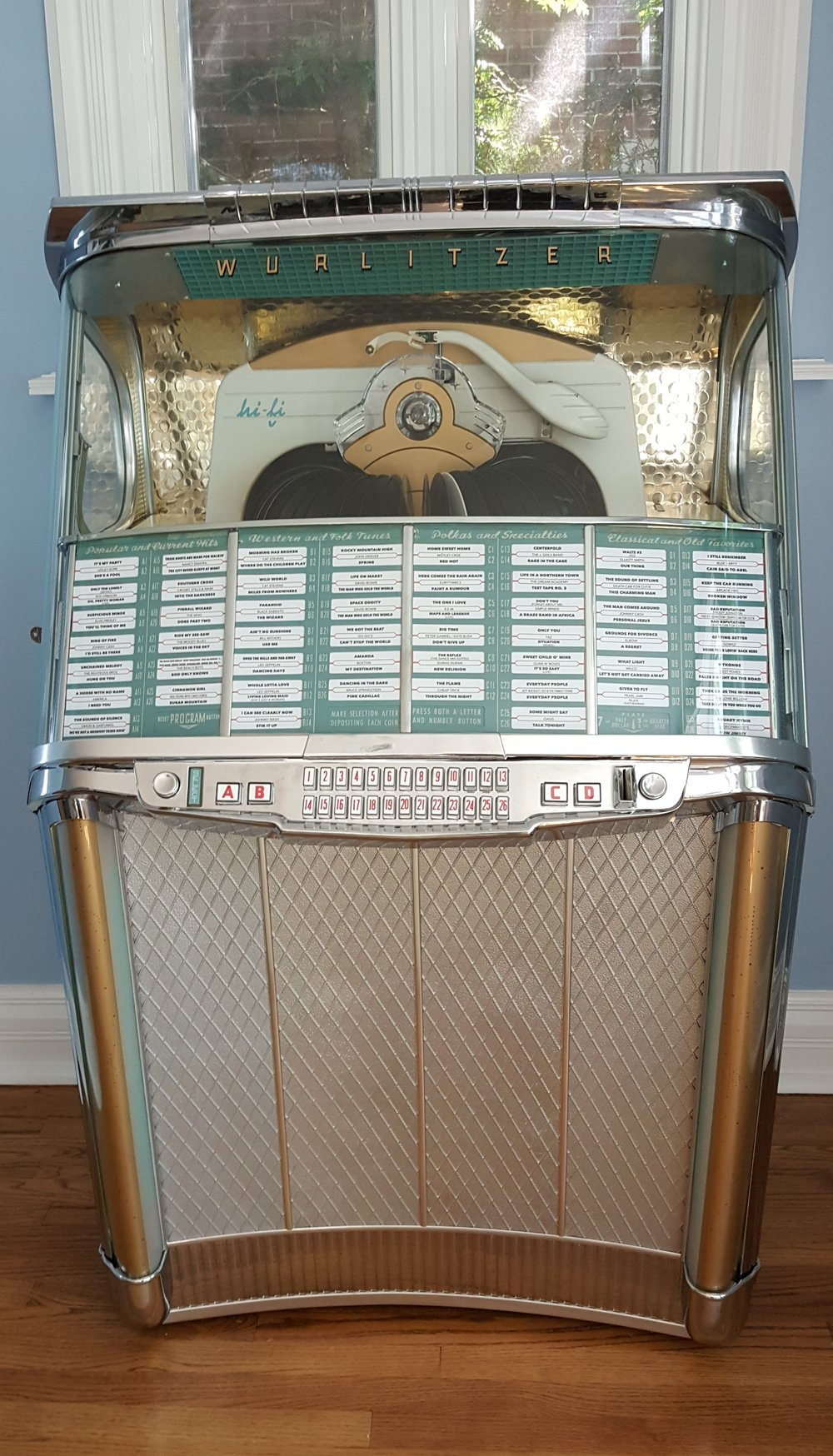 It is a jukebox. And it's a Wurlitzer. And it's mint. My clients husband had this baby delivered a few weeks ago and it's driving the vibe for the room refresh. Dance party on reveal day!