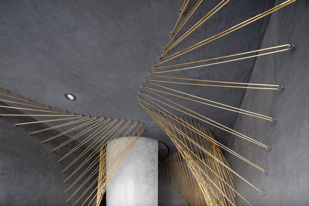 Golden trellis surrounds the shower area.