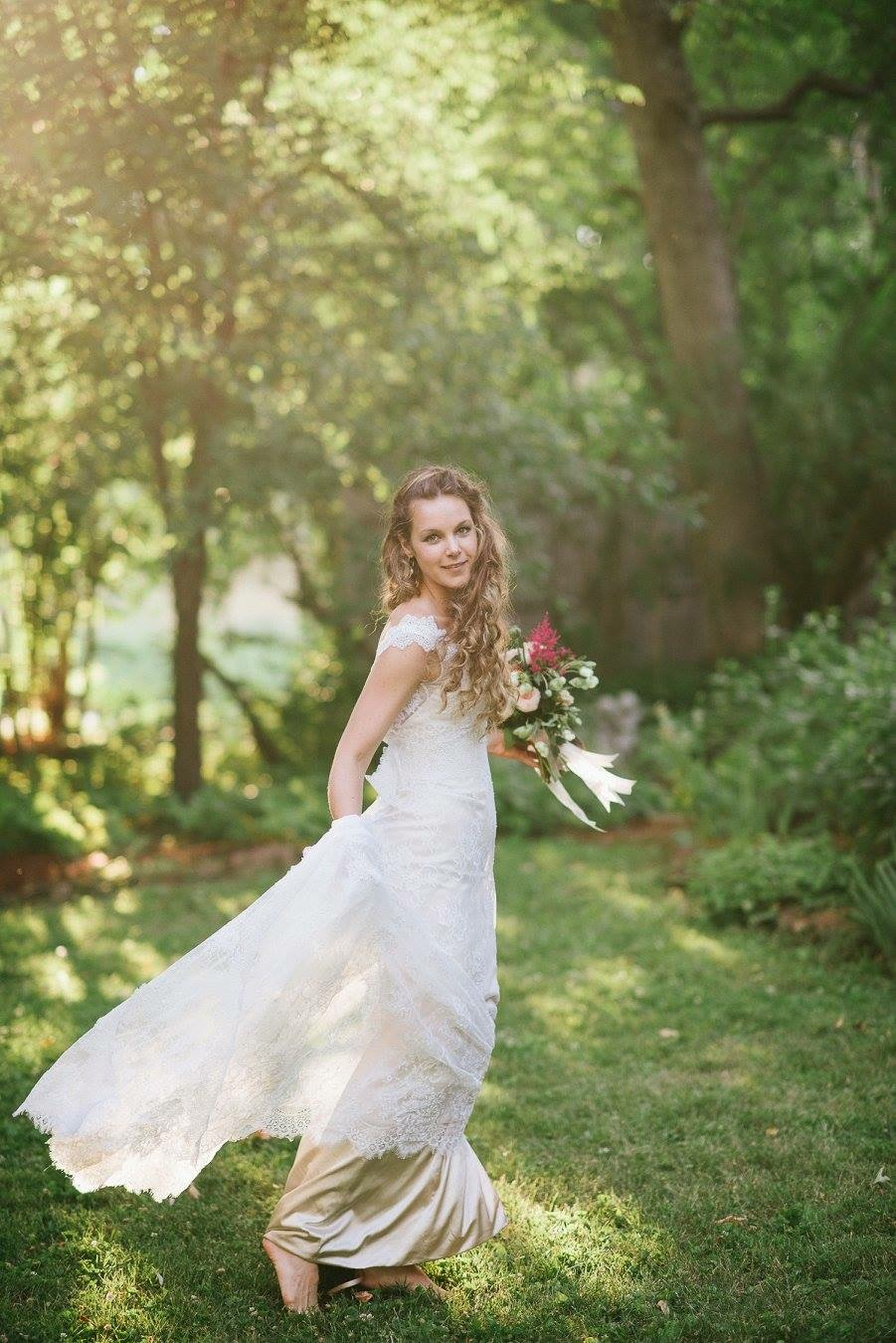 sunlight through trees on twirling bride