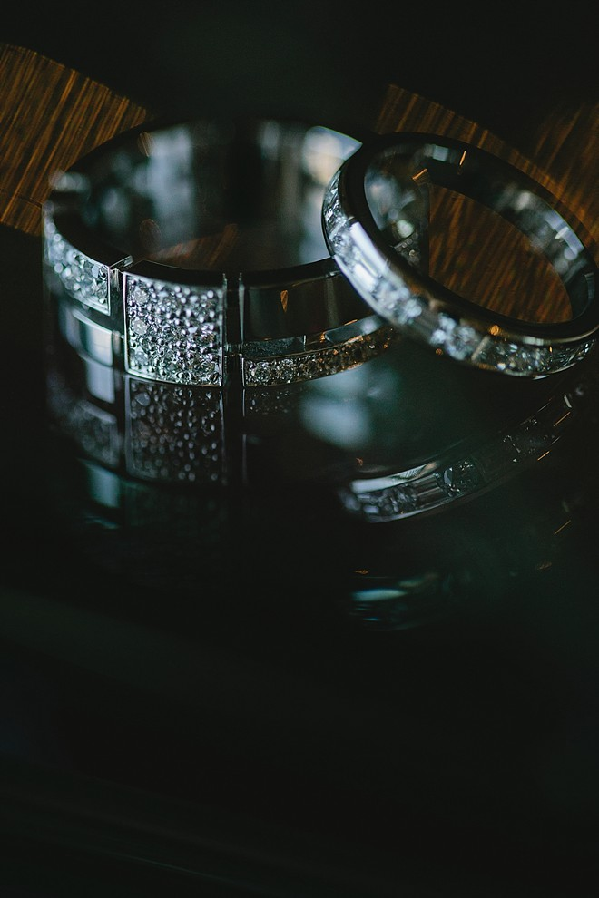 wedding rings on black surface