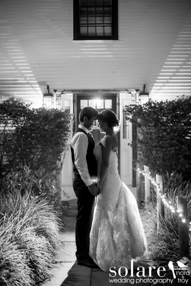 bride and groom kiss under the stars