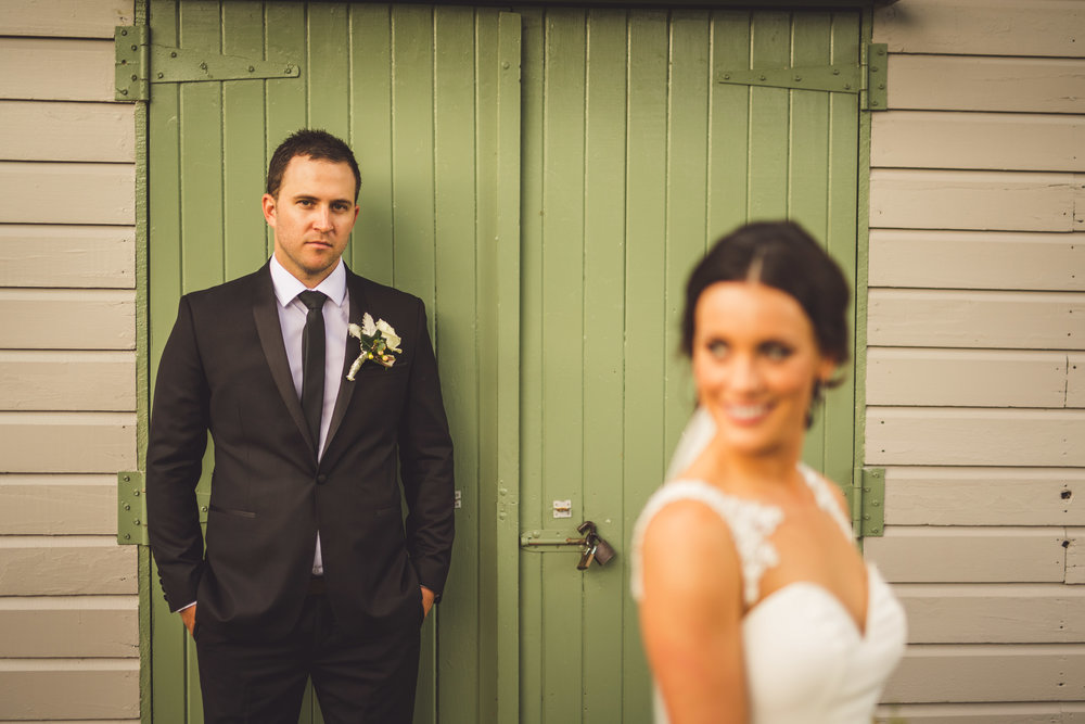 groom and bride green door photo
