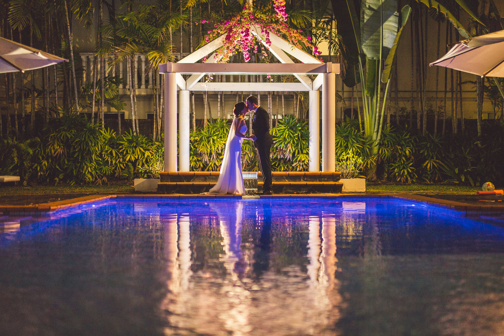 the reef house pool bride and groom under the stars