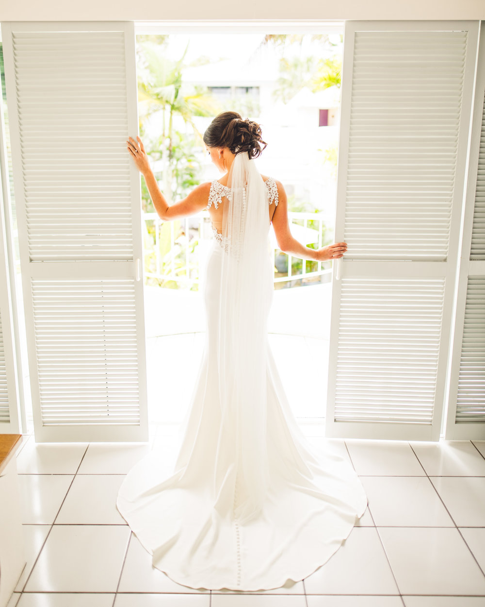 bride in doorway before ceremony