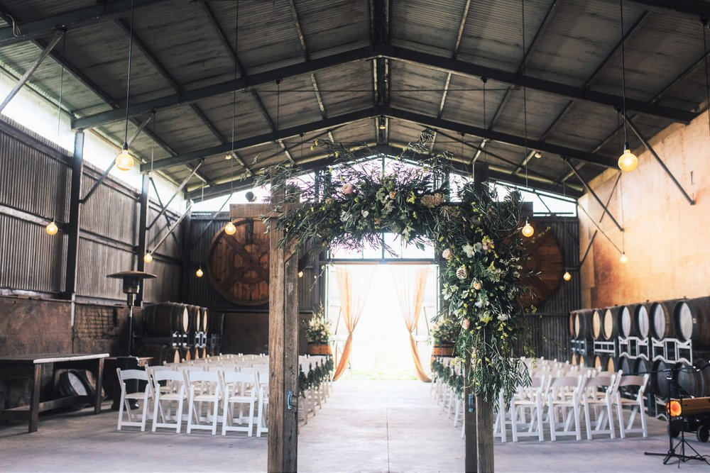 Vineyard Wedding Ceremony with Arbor and Edison Lights