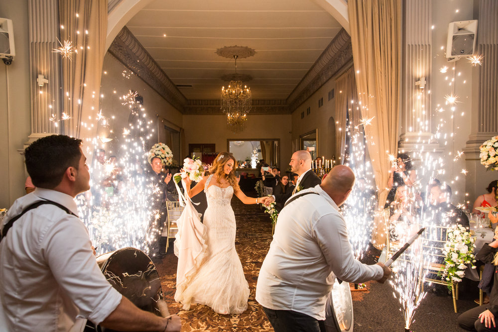 Sparklers lining wedding aisle