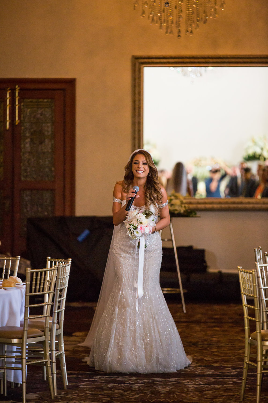 Bride serenading groom walking down aisle