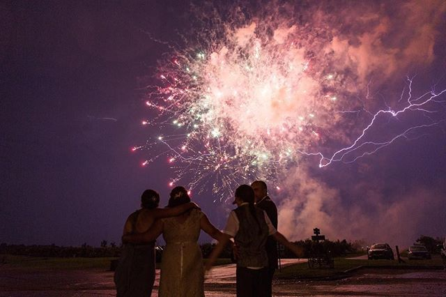 📸: @corey_garland_photography 😲🎆✨⚡️🎇 A bolt of lightning streaming through the sky during  a fireworks display during this stormy, mid-summer wedding.