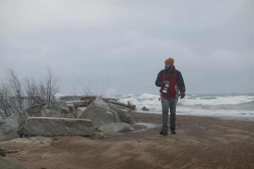 Jason getting soaked in cold waves and rain at Lake Michigan in New Buffalo