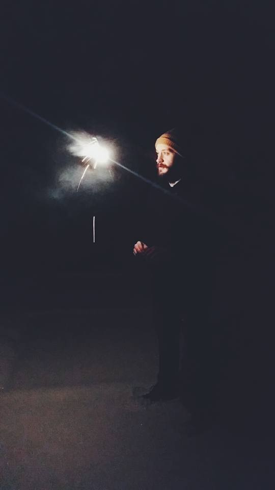 Jason playing with fireworks in snow