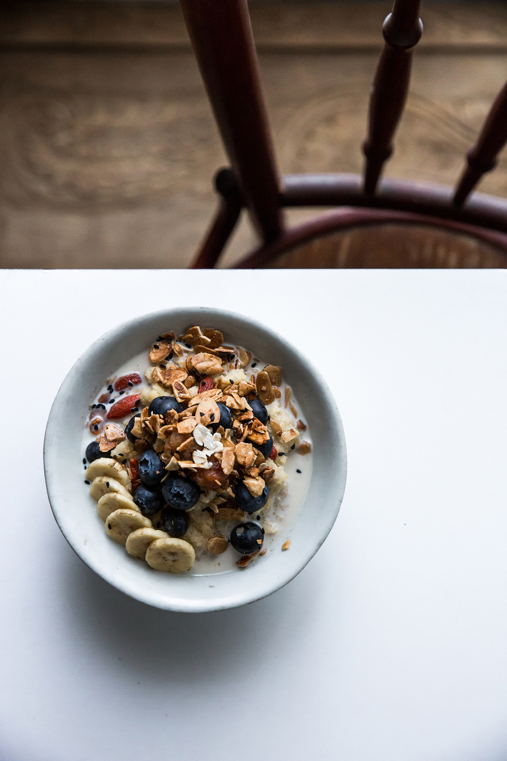 Goji Multigrain Congee w/ Spiced Granola, Fresh Berries & Banana