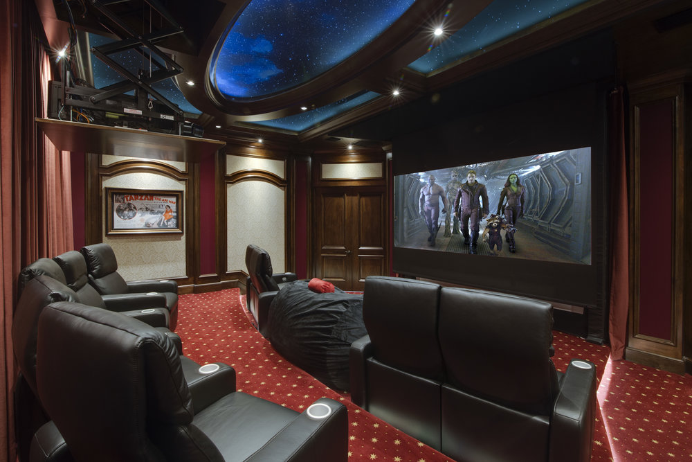 HOME THEATER - When someone thinks of a custom home theater they automatically think of a huge price tag staring back at them. Although this is true for some theaters, just like everything else in our industry, a theater can be what you make it. There are theaters that cost hundreds of thousands of dollars with carpet flown in from Egypt and hand carved woodwork, but there are also very affordable theaters that can still give you a high quality cinema experience in the comfort of your own home. Let us know your needs, wants and budget and our team of engineers and designers can put together a solution to match.