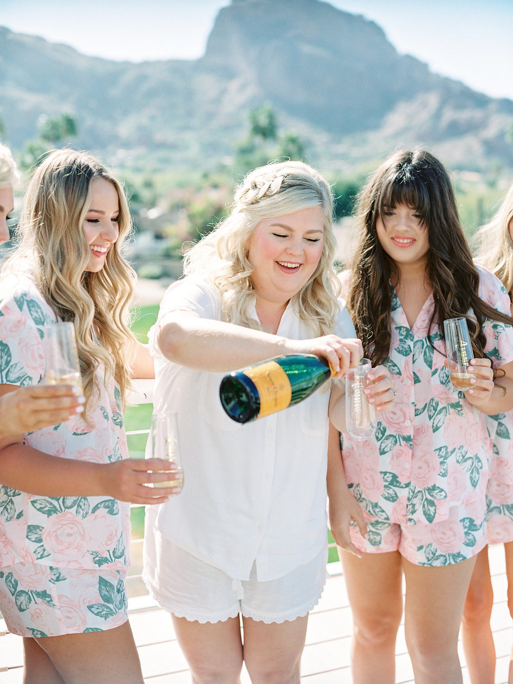 bride pouring champagne.jpg