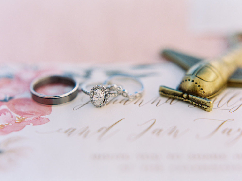 Wedding rings with airplane.jpg