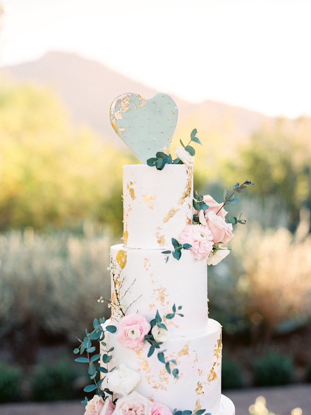 Blush and gold flaked wedding cake.jpg