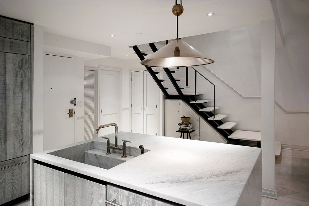 eastvillagetriplex-eau-kitchen-counter-stairs.jpg